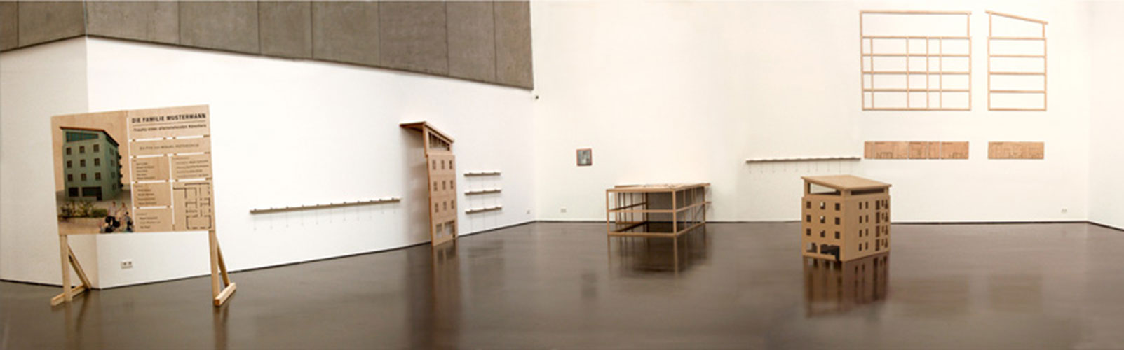 The Mustermann Family - Trauma of an Unattached Artist, © 2001 - 2003, Film Installation consisting of 7 parts in plywood, 67 flip-books and 1 photography, variable size, house parts: scale 1:10, model 1:20