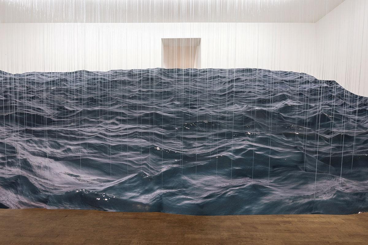 Elegy, © 2017, print on fabric, fishing line, lead balls, epoxy, acrylic 300 x 550 x 280 cm